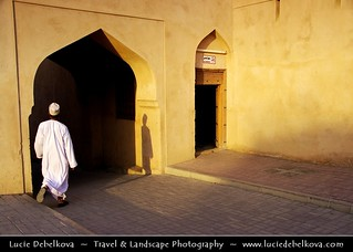Oman - Lonely Man Walking through Old Souq of Nizwa During Late Afternoon