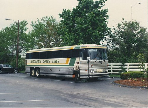 Wisconsin Coach Lines bus in the parking lot of the Kentucky Horse Farm. Lexington Kentucky. May 1990. by Eddie from Chicago