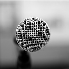 white(0.0), microphone(1.0), electronic device(1.0), sphere(1.0), monochrome photography(1.0), close-up(1.0), audio equipment(1.0), circle(1.0), monochrome(1.0), black-and-white(1.0),