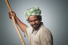 Portrait of indian villager while working in a salt field