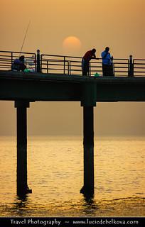 Kuwait - Fishing under the setting sun at Souq Sharq