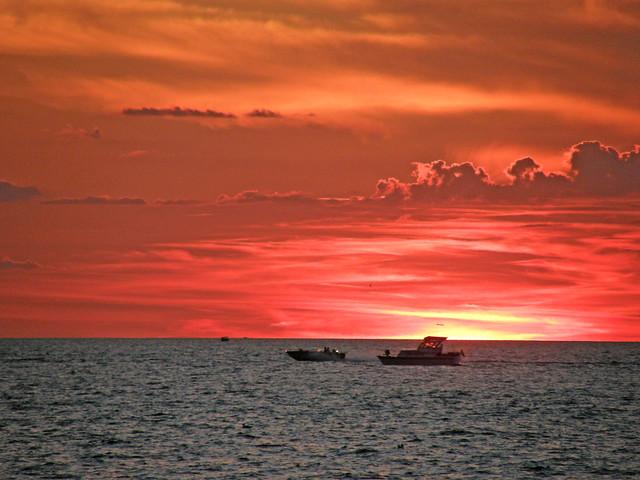 Sunset Race - Speedboat Passes Yacht