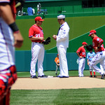 Sailor of the Year talks to pitcher prior to a Washington Nationals and Florida Marlins game
