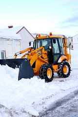 asphalt(0.0), tool(0.0), tractor(0.0), vehicle(1.0), snow(1.0), snow removal(1.0), snowplow(1.0), snow blower(1.0),