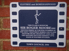 Photo of Roger Moore film cell plaque