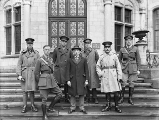 The Prime Minister of Australia William Hughes and six unidentified officers