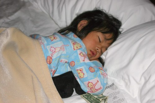 Olivia Sleeping with Puppy and Money