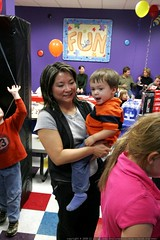 fun   noa watches the party from his mom's arms    M…