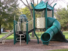 backyard(0.0), playhouse(0.0), play(0.0), recreation(0.0), outdoor recreation(0.0), leisure(0.0), swing(0.0), outdoor play equipment(1.0), playground slide(1.0), city(1.0), public space(1.0), playground(1.0),
