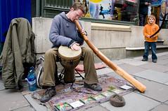 road(0.0), musical instrument(1.0), street artist(1.0), street(1.0),