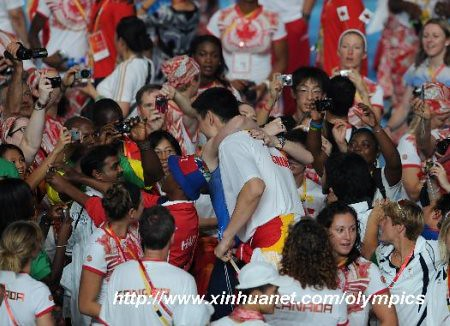 August 24th, 2008 - Yao Ming is hugged by Australian basketball player Lauren Jackson at the Closing Ceremonies of the Olympic Games