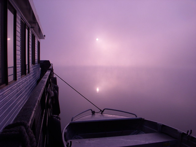 Mist and boats at sunrise