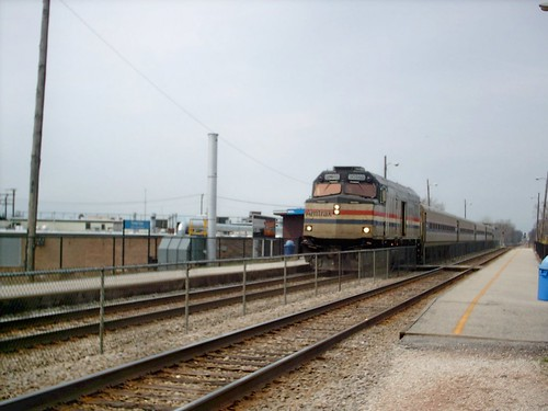 Southbound Amtrak train from Milwaukee Wisconsin passing through the Metra forest Glen commuter rail station on Chicago's far northwest side. Chicago Illinois. March 2007. by Eddie from Chicago
