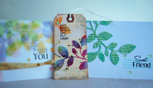 three stenciled cards