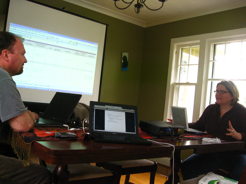Photo of 2 people working from home