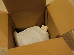 furniture(0.0), wood(0.0), paper(0.0), bed(0.0), brown(1.0), cardboard(1.0), carton(1.0), box(1.0),