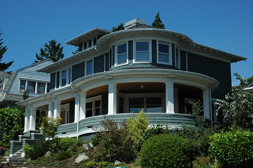 Rotunda porch house, teal gray and white trim, clear day in summer, Greenlake, Seattle, Washington, USA by Wonderlane