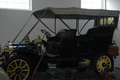 carriage(0.0), automobile(1.0), wheel(1.0), vehicle(1.0), touring car(1.0), antique car(1.0), vintage car(1.0), land vehicle(1.0), ford model t(1.0), classic(1.0),