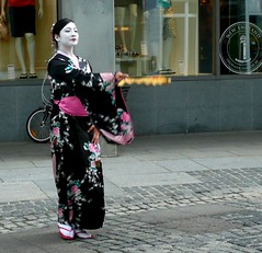 geisha(1.0), clothing(1.0), kimono(1.0), woman(1.0), fashion(1.0), female(1.0), costume(1.0), person(1.0), dress(1.0),