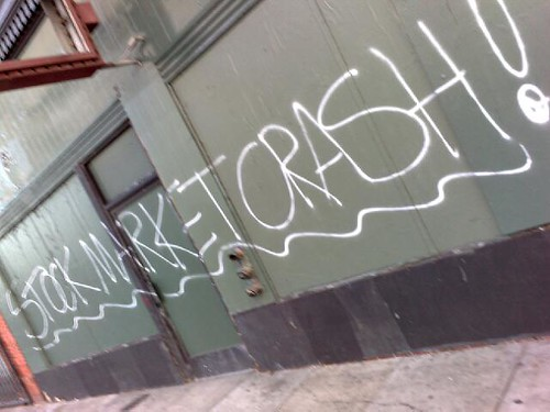 Stock market crash graffiti on a wall