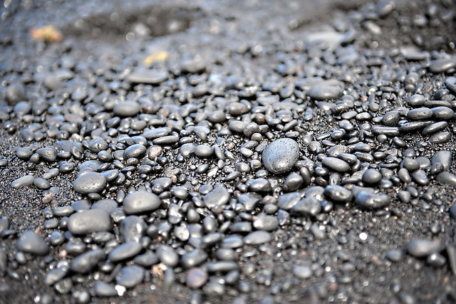 Black sand and pebbles in Waianapana State Park in Hana