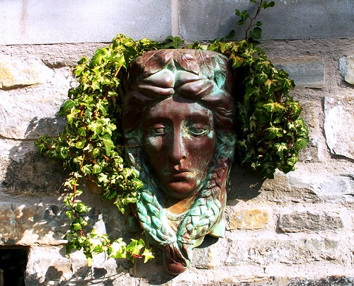 Chalice Well Gardens: Entrance Greenwoman by phoenixspringwater