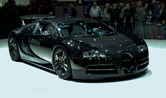 model car(0.0), automobile(1.0), bugatti(1.0), wheel(1.0), vehicle(1.0), performance car(1.0), automotive design(1.0), auto show(1.0), bugatti veyron(1.0), land vehicle(1.0), luxury vehicle(1.0), supercar(1.0), sports car(1.0),