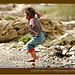 child-jumping-puddles-tibet