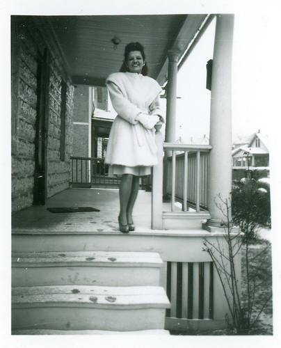 Holli on porch in snow  312