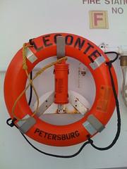machine(0.0), wheel(0.0), personal flotation device(0.0), electrical wiring(0.0), orange(1.0), lifebuoy(1.0), circle(1.0),