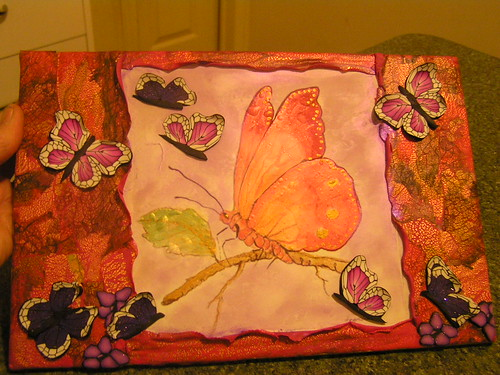 Altered art transfer with butterflies and edges in clay