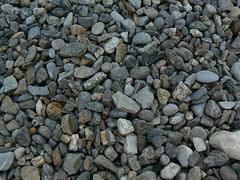 asphalt(0.0), stone wall(0.0), wall(0.0), soil(0.0), flooring(0.0), rubble(1.0), pebble(1.0), stream bed(1.0), rock(1.0), gravel(1.0),