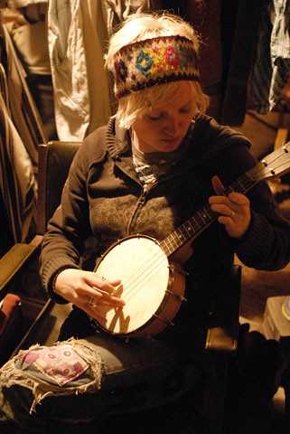 Michael playing her uncle's banjo ukelele