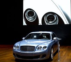 model car(0.0), automobile(1.0), automotive exterior(1.0), bentley continental supersports(1.0), wheel(1.0), vehicle(1.0), performance car(1.0), automotive design(1.0), bentley continental gtc(1.0), bentley continental flying spur(1.0), grille(1.0), bentley continental gt(1.0), bumper(1.0), sedan(1.0), land vehicle(1.0), luxury vehicle(1.0), bentley(1.0),