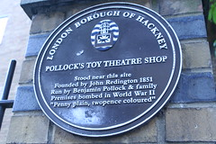 Photo of Pollock's Toy Theatre Shop, John Redington, and Benjamin Pollock plaque