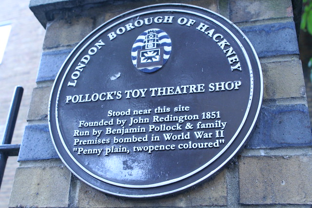 """Pollock's Toy Theatre Shop, John Redington, and Benjamin Pollock plaque - Pollock's Toy Theatre Shop Stood near this site  Founded by John Redington 1851  Run by Benjamin Pollock & family  Premises bombed in World War II  """"Penny plain, twopence coloured"""""""