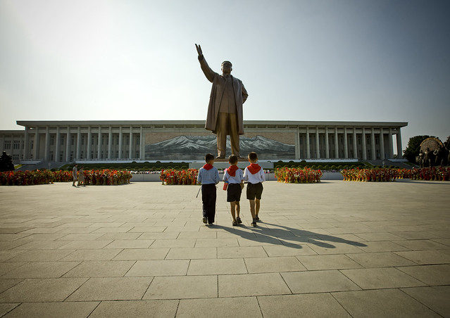 3 pioneers at Mansu hill North Korea