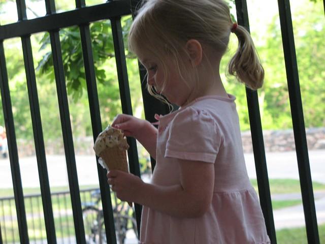 Girl eating ice cream - very carefully -  at SeaSalt restaurant
