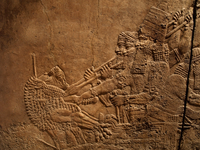 Assyrian relief carving king spearing lion flickr