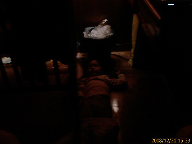 Christina sleeping on the floor next to the bed