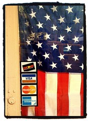 credit card logos and USA flag on shop door