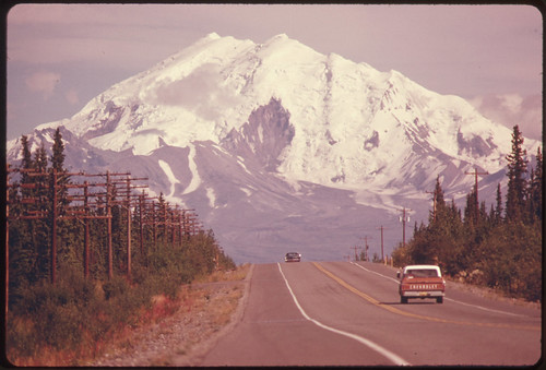 View East Along Glen Highway Toward Mount Drum (Elevation 12,002 Feet) and Intersection of Road and Trans-Alaska Pipeline...08/1974