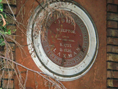 Photo of John Flaxman brown plaque