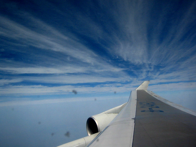 Clouds outside of airplane window - Flickr Emily Sullivan