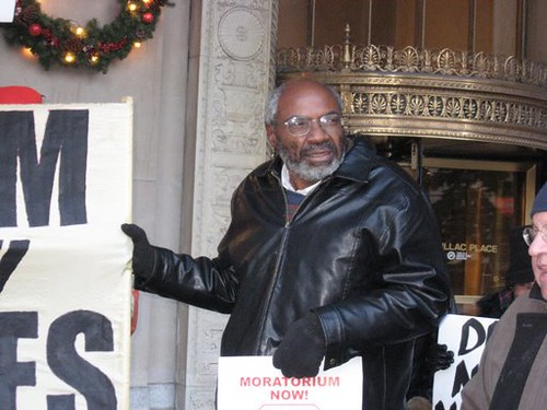 Abayomi Azikiwe, editor of the Pan-African News Wire, covering a demonstration held by the Moratorium Now! Coalition on November 20, 2008 outside the state office building, Cadillac Plaza in Detroit. (Photo: Alan Pollock). by Pan-African News Wire File Photos