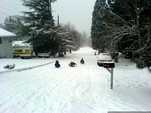making good use of the snowed over streets by sledding   DSC02214