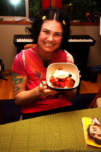 rachel with her birthday cake   strawberries, blueberries and whipped cream on angel food cake    MG 4858