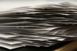 A pile of papers on a desk.