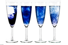 martini glass(0.0), champagne(0.0), beer glass(0.0), wine glass(0.0), wine(0.0), drinkware(1.0), stemware(1.0), cobalt blue(1.0), glass(1.0), champagne stemware(1.0), drink(1.0), alcoholic beverage(1.0),