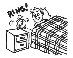 Boy waking to an alarm clock
